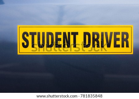 Yellow student driver magnetic on car door