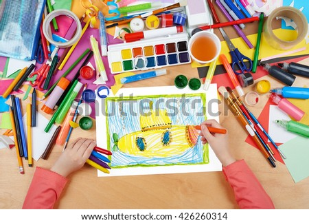yellow submarine underwater child drawing, top view hands with pencil painting picture on paper, artwork workplace