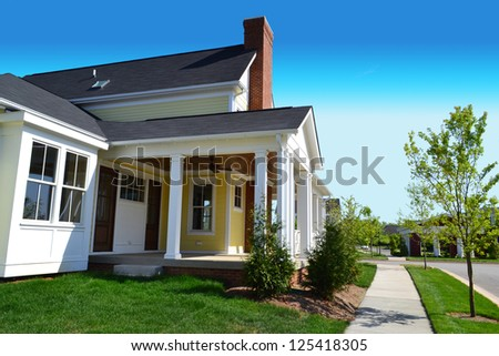 Yellow Suburban American New England Style Dream Home with Large Front Porch