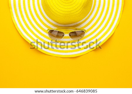 yellow sunglasses and striped retro hat. summer concept