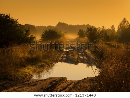 yellow sunrise over country road