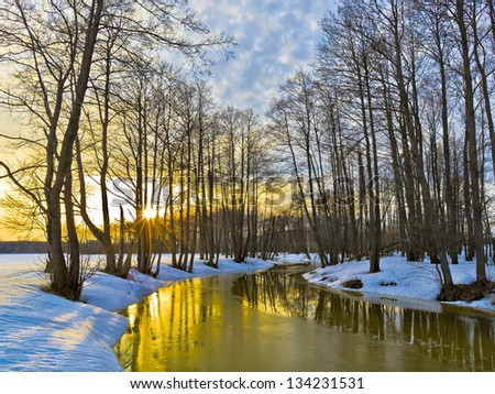 Yellow sunset in early spring. River Sukhodrev. Kaluga region. Russia