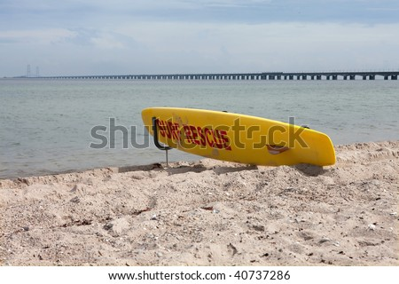 Yellow surf board ready to rescue people from drowning