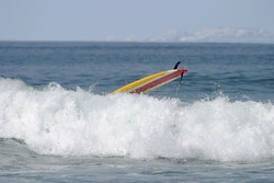 Yellow Surfboard Wipeout