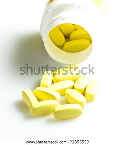 yellow tablets isolated on a white background