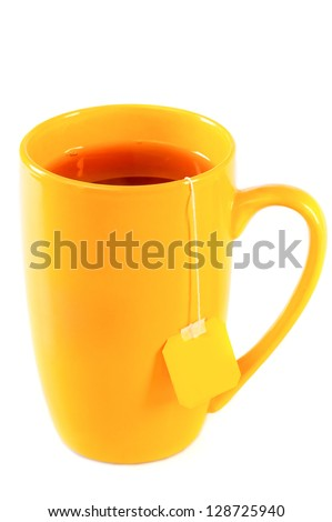 Yellow tall mug of tea with a label of packaged tea