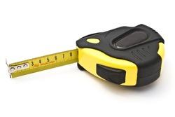 Yellow tape measure closeup on white background
