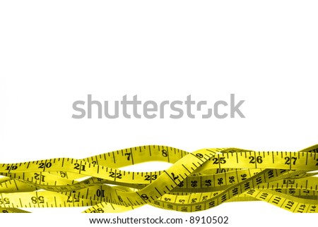 yellow tape measure, tangled, against white ground; excellent border; good copy space; clipping path included