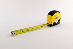 Yellow Tape Measurer with white background.