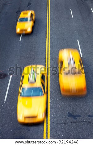 Yellow taxi cabs in motion in New York City