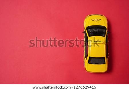 yellow taxi car - top view . Transport sign, auto, drive and symbol. red background. empty copy space for inscription.  #1276629415
