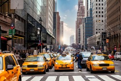 Yellow Taxi in Manhattan, New York City  in USA sunset