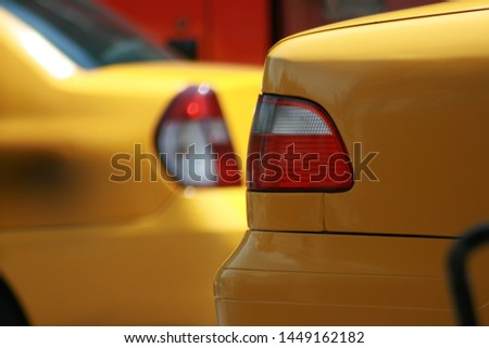 Yellow taxi lights on traffic. Transport #1449162182