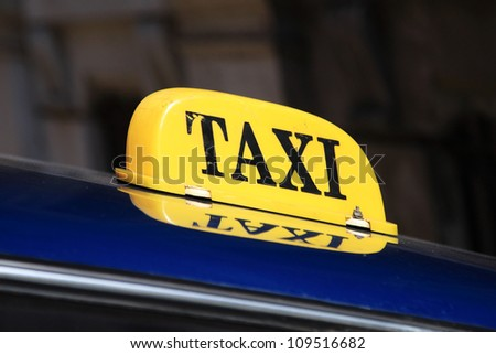 Yellow taxi sign in Havana, Cuba