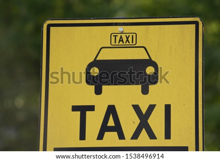 Yellow Taxi sign with pictogram of a car #1538496914