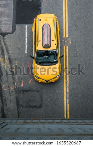 Yellow taxi top view in New York