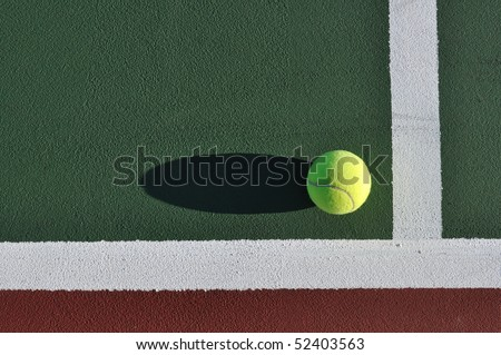 Yellow Tennis Ball Near Baseline of Tennis Court