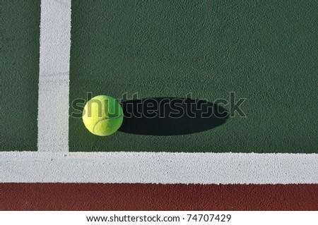 Yellow Tennis Ball Near Baseline of Tennis Court