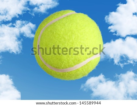 Yellow Tennis Ball on a Clear Blue Sky Background