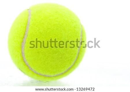 Yellow tennis ball on white background