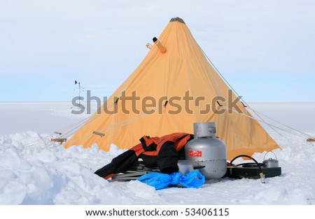 Yellow tent and camping equipment