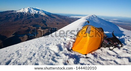 Yellow tent pitched at the top of volcano