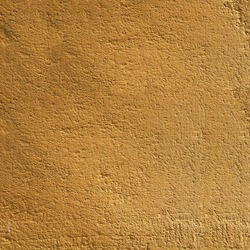 Yellow textured wall Gold colored textured blank wall.
