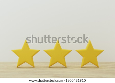 Yellow three star shape on table. The best excellent business services rating for satisfaction.