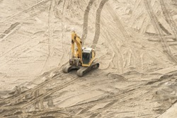 Yellow Tracked Excavator or Trackhoe working at construction area