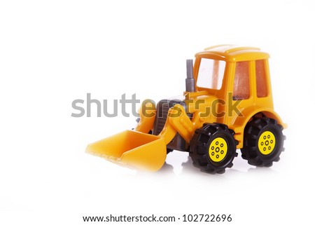 yellow tractor toy on a white
