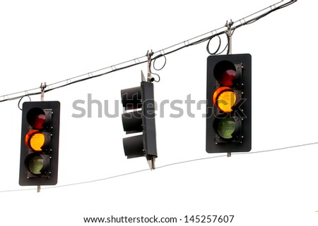 Yellow Traffic Lights Hanging From Wires Overhead Close