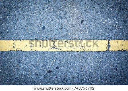 yellow traffic line on asphalt...