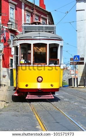 Yellow tram in Alfama district of Lisbon, Portugal symbol