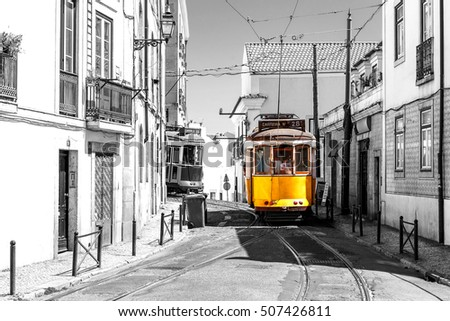 yellow tram on old streets of...