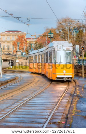 Yellow trams - Ground is covered with red fallen leaves in Budapest, Hungary #1292617651