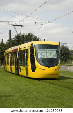 Yellow tramway in Mulhouse, France. Front view