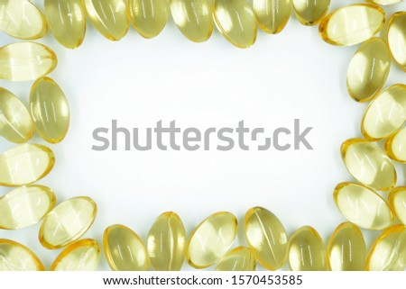 Yellow transparent capsules. Frame of capsules with vitamin E. Omega 3 capsules.