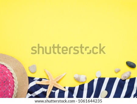 Yellow travel concept for see or beach. Hat, seastar, towel, sundress with stripes. Flat layout summer.  Traveller accessories. #1061644235