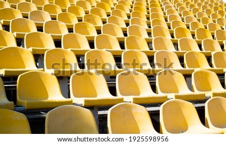 yellow tribunes. seats of tribune on sport stadium. empty outdoor arena. concept of fans. chairs for audience. cultural environment concept. color and symmetry. empty seats. modern stadium. Stock photo ©