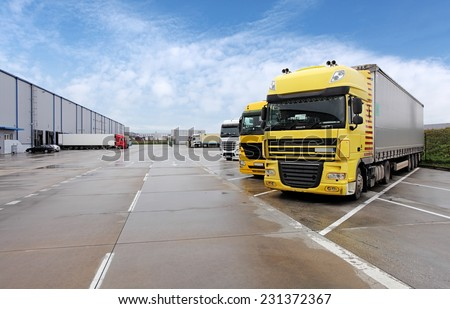 Yellow truck in warehouse #231372367
