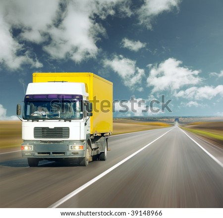 Yellow truck on road under blue sky #39148966
