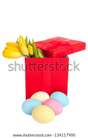 Yellow tulips in festive red box with easter egss
