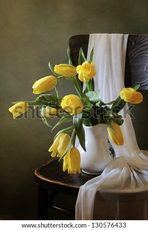 Yellow tulips on a chair