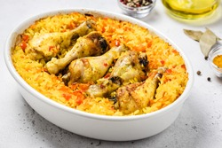 Yellow turmeric chicken curry rice casserole in baking dish. Space for text.