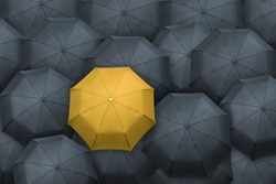 Yellow umbrella stand out from the crowd. Leader concept.