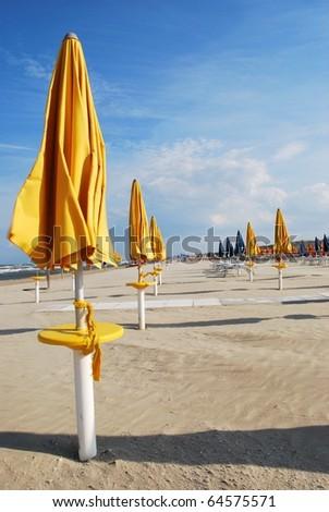 Yellow umbrellas on the beach, Rimini, Italy