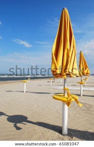 Yellow umbrellas on the beach, Rimini, Italy
