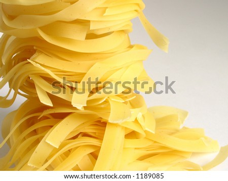 yellow uncooked noodles #1189085