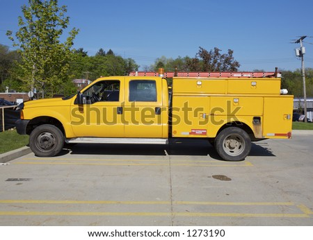 Yellow Utility Truck Sideview