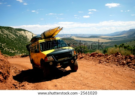 Yellow Van with Sea Kayaks on Mountain Road in Colorado